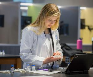 Female pharmacy student in skills lab