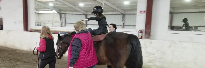 patient riding a horse